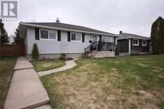 Stunning updated Bungalow is looking for a new family!! What it offers; Newer Windows w/Hunter Douglas blinds, Exterior Doors, Central Air, Shingles, Vinyl Siding, Fence