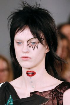 Bowie-inspired makeup at Maison Margiela couture - Ziggy embodied the glam rock style, sporting red hair, heavy makeup, and incorporating elements of performance art when he took the stage.
