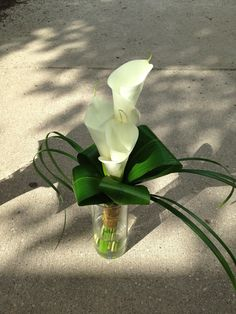 Bridesmaid bouquet with 3 cala lilies. |  Baumann's Florist