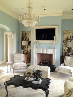 Living Room Display flush mounted above fireplace with custom frame, in-ceiling surround sound and Crestron Control.