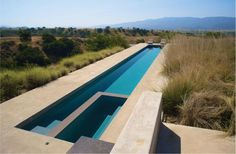 Natural gardens contrast with modern pool