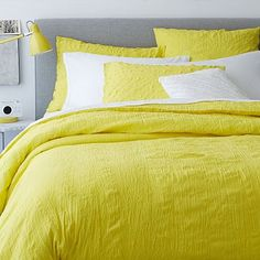Would love this yellow duvet with my bedroom's gray walls and sheets. Crinkle Duvet Cover + Shams - Sun Yellow #westelm