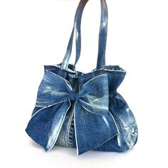 This gorgeous bow bag is one of my recycled bags collection. I made it out of a blue jean pant which is touched by ivory paint. An elastic band