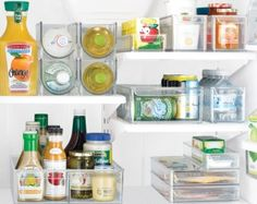 I bought one of the shelf drawers for the fridge at Bed, Bath & Beyond.  Now you can see every condiment jar on the shelf easily by sliding it out!