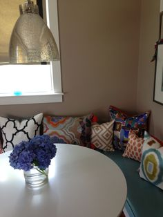 Colorful mix of pillows in a casual breakfast nook.