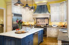 Love the style, layout and cabinets of this old world kitchen. (Not too keen about the colors!)