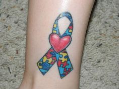 Google Image Result for http://www.ratemyink.com/images/ul/139/autism-ribbobn-tattoo-139939.jpeg