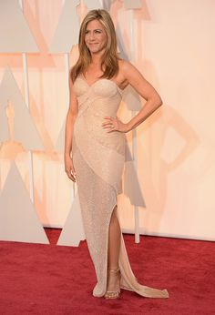 Jennifer Aniston in Atelier Versace, with Fred Leighton jewels | Oscars 2015: 40 of the best dressed stars on the red carpet