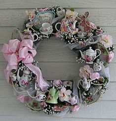 Miniature tea cups and teapots adorn this wreath with lace and pearls