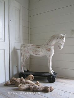 Lil Buckeroo ♥s this white wooden horse
