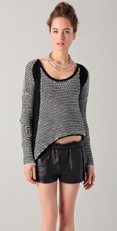 Strangely attracted to this odd sweater. O would obviously keep my belly covered!!
