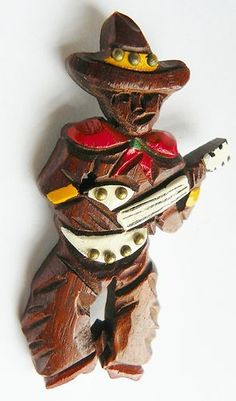 1940s Wood Cowboy Brooch ~ carved walnut.  Colleen Abbott (colleen466) is the original pinner of this pin.