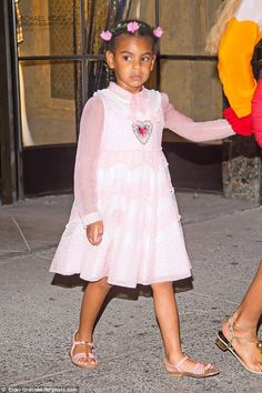 Pink princess:Blue Ivy looked particularly adorable in a sweet pink frilly frock that made her look like a little angel