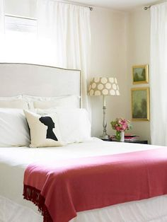 Bed in front of window, a must do master bedroom scheme. Love the neutral color with pink.