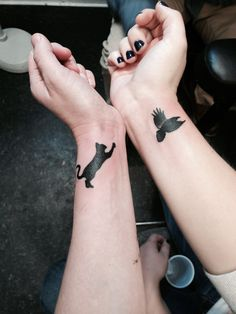 Best friend tattoos. Work together and separately! My friend Kat got the playful cat and I got a raven for my love of birds, the brilliant Corvids and a little bit of Charm City pride!  #tattoos #bestfriends #tattooideas #birdtattoo #cattattoo #bestfriendtattoos