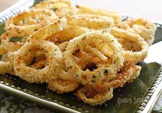 Low Fat Baked Onion Rings  Adapted from Life as a Lofthouse   Gina's Weight Watcher Recipes  Servings: 2 • Serving Size: 1/2 • Old Points: 1 pt • Points+: 2 pt  Calories: 74.7 • Fat: 0.6 g • Carb: 14.7 g • Fiber: 1.6 g • Sugar: 1.7 g • Protein: 2.9 g         1 medium onion, sliced into 1/4 inch rings  2 1/4 cups low fat buttermilk  1/2 cup panko bread crumbs  1/4 cup Italian seasoned whole wheat bread crumbs  1/4 cup crushed corn flake crumbs  salt to taste   olive oil baking spray (I used m...