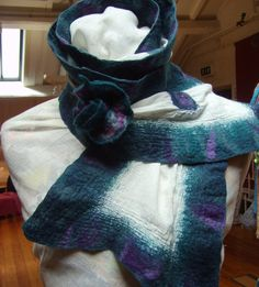 A unique OOAK handmade Nuno felted scarf.     I have used soft Merino wool fibers to which I have layed onto a lightweight muslin cotton, as the