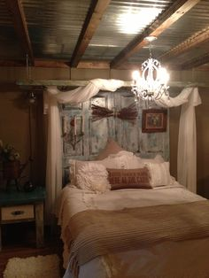 This is my new decorated bedroom. Used old ladder for curtains and painted old doors for headboard