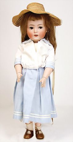 "KÄMMER & REINHARDT 117 N, ""Mein Liebling"", 55 cm, socket head, brown impish eyes, opened mouth, upper teeth, dimple at chin, toddler body with pulled up knee joints, old real hair wig"