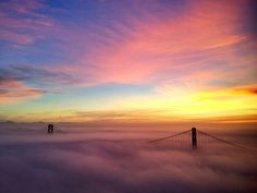 SF Bay Bridge at sunrise in the clouds  Want to go and take Savannah!