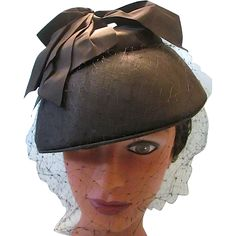 This delightful netted 1950s cocktail hat has a bowl shape with silk like  ribbons piled on 6b68872ec0cd