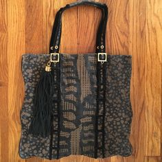 Tory Burch Tote Adorable Tory Burch animal print tote with black suede tassel. Very cute bag! The fabric is a little faded and there is a light blue ink stain inside at the bottom of the purse. Otherwise a great bag with lots of life! Tory Burch Bags Totes
