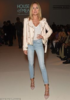 Less is more:Kimberley rocked the FROW in a cream leather jacket thrown over her white t-...