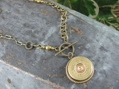 12 gauge shotgun shell medallion necklace ~ this does kind of get the message across.