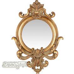 Barok Spiegel Rond Goud  Barok Spiegel Rond Goud. Aan de boven en onderzijde mooi versierd  met krullen.  Kleur: Antiek Goud  Materiaal: Polystone  Afmetingen: Hoogte : 60 cm Breedte: 42.2 cm Diepte: 5 cm  RESIN WALL MIRROR ROUND