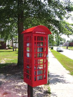 Little Free Library - Little Red Phone Booth -- I want to put this one in front of my house with an iron reading bench so my neighbors have a comfortable spot to browse the books.