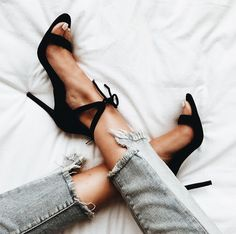Chic black heels with jeans.