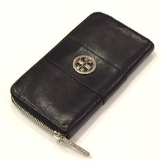 Tory Burch Black & Silver Continental Wallet Tory Burch Continental Wallet. Black leather; silver tone hardware. Zip around closure. *Shows some wear on logo* Tory Burch Bags Wallets