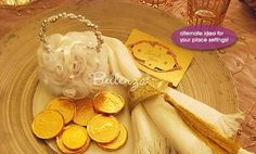 Exotic place setting - embossed gold ribbon as napkin accent, pomander sachet with ornate gold tag, gold chocolate coins