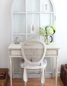 Another great way to use a vintage arched door.  You could use it as a place to put photos.