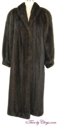 "Long Mahogany Mink Coat #MM793; $1200; Very Good Condition; Size range: 8 - 16. This is a gorgeous genuine natural mahogany mink fur coat in a very deep, dark almost ranch mink color and in a nice long length. It has an Evans label and features a small shawl collar, banded bracelet cuffs, and has shoulder pads.  This is a high-quality mink coat which is fully interlined and has very generous 14"" sleeve openings to accommodate bulky clothing. Buy this elegant dark mahogany mink coat and be ha..."