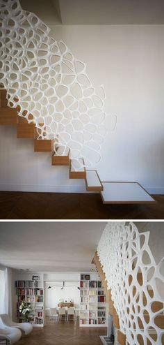 This white sculptural railing running the length of the staircase is made from Corian to make sure it's strong, durable, and able to withstand lots of use over the years.