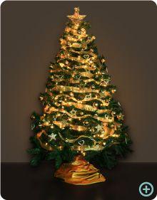 Instalamos un rbol de navidad plateado a una reconocida - Arbol navidad dorado ...