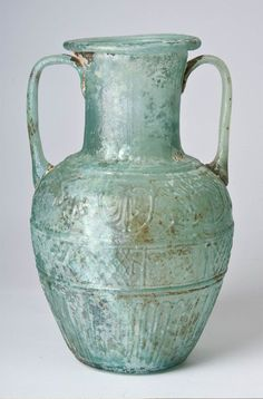 Two-handled jug (amphora) signed by Ennion. Roman, blown in a four-part mold, first half of 1st century a.d.; from the Shlomo Moussaieff Collection.