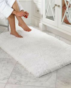 Frontgate's unique Belize Memory Foam Bath Rug is the softest and plushiest bath mat you'll ever sink your feet into.