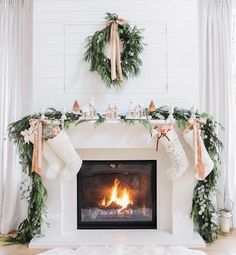 Pretty Christmas mantle with stockings and a wreath.