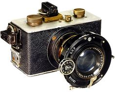 """Steinheil - Test Camera - Steinheil. c. 1922 Extremely early camera for 35 mm. Wooden body, leathered, top plates of aluminium, inner brass body. Extremely fast Steinheil """"Cassar 2,5/7,5 cm"""", No. 288.433."""