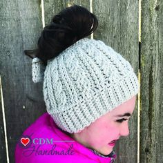 A free crochet pattern for a cabled messy bun bow hat. This is an  intermediate skill pattern but the result is just elegant. 146c5ca4b84