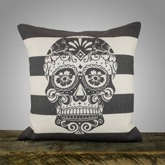 "Sugar Skull Pillow Cover, Black and White Stripe Pillow, Decorative Throw Pillow, Day of the Dead, 16"". $46.00, via Etsy."