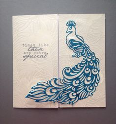Blue tattered lace peacock on a bi-fold card
