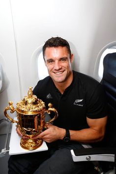 NOVEMBER 05. 2015 Dan Carter of the All Blacks poses with the Webb Ellis Cup enroute to Christchurch for homecoming celebrations.