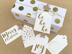 Gold is On Trend - Simple white paper with sticky gold dots such on together with macaroon's gold cord and Beautiful gold foiled tags make the most classic, elegant and classy Christmas gift wrapping theme this year - all available online www.macaroon.co.za