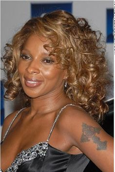 mary j blige  Is by far the best female R artist alive and very beautiful but has been through a lot in her past with her Ex boyfriend KC and came out a strong women