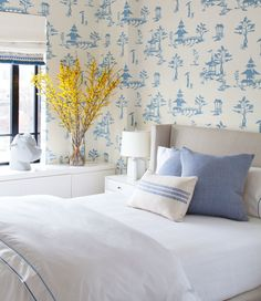 Chinoiserie wallpaper adds charm to this guest room | archdigest.com