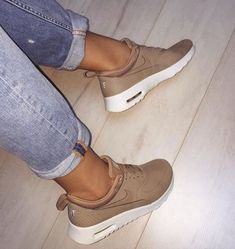 Beige / nude nike shoes. Can match any casual outfit. Also work for any season. Summer, fall, winter, or spring outfits.