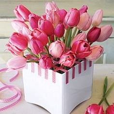 Love pink Tulips! This is a great idea as tulips have a mind of their own, the colors and choices of containers is limitless.